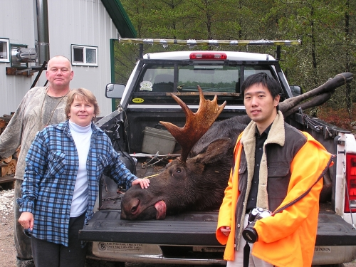 Ruth and Frank, PRTC staff members, show off their prize from the 2007 moose hunt.  This was Frank's first hunting experience!