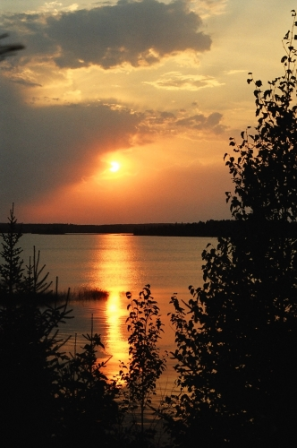 Bright orange sunset on the waters of Wabaskang