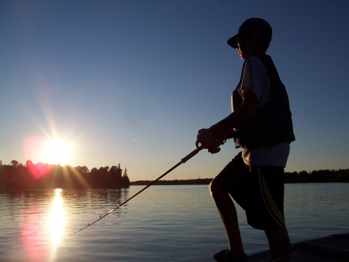 Kellie's son gets in his last chance at fishing at the end of their vacation at Bonny Bay Camp on Wabigoon Lake.