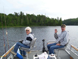 A friendly wave from the pontoon boat on Eagle Lake.  We're out enjoying the weather, the company and the fishing is a bonus!