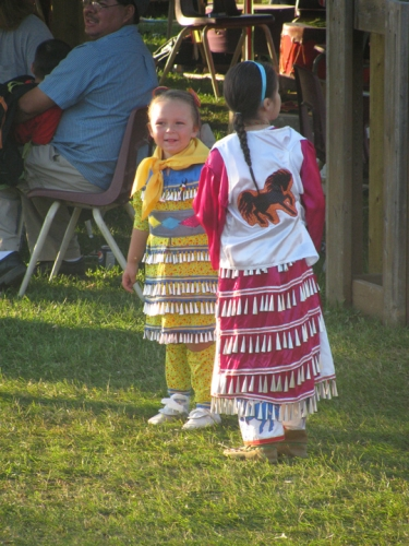 Two of the young participants at the Annual Pow Wow in Eagle River proudly show off their jingle dresses.