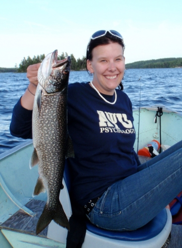 What better way to spend a summer day in Ontario's great Northwest than fishing.  Vanessa shows off her nice trout.  Could that be dinner tonight?
